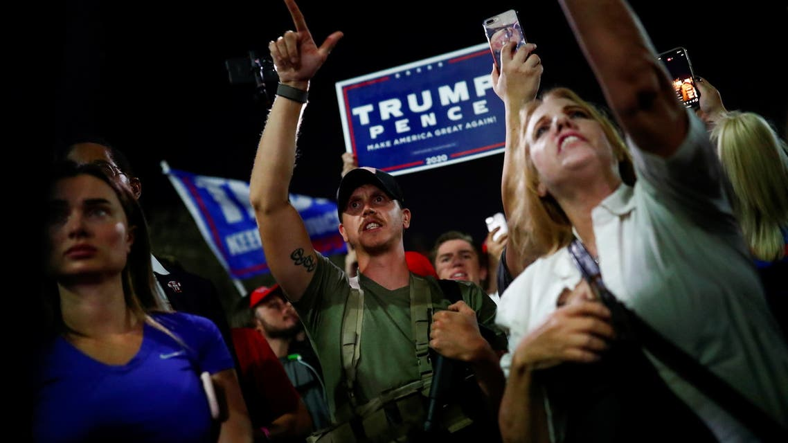 A supporter of US President Donald Trump gestures during a protest about the early results of the 2020 presidential election, in front of the Maricopa County Tabulation and Election Center (MCTEC), in Phoenix, Arizona November 4, 2020. (Reuters)