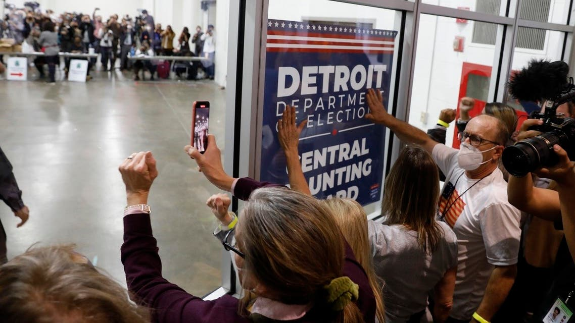 Protesters bang on the glass outside the room where absentee ballots for the 2020 general election are being counted, Nov. 4, 2020 in Detroit, Michigan. (AFP)