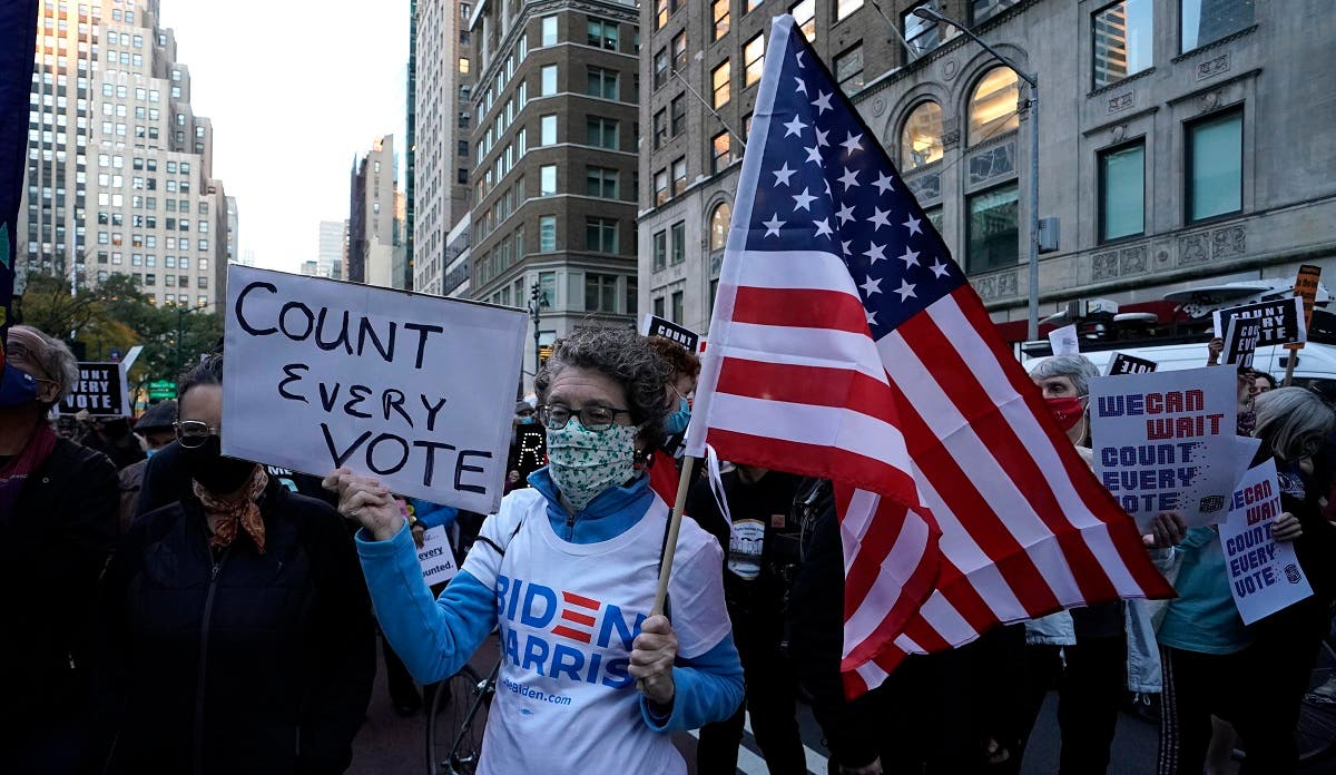 People gather at Fifth Avenue during a Count Every Vote rally in New York on Nov. 4, 2020. (AFP)