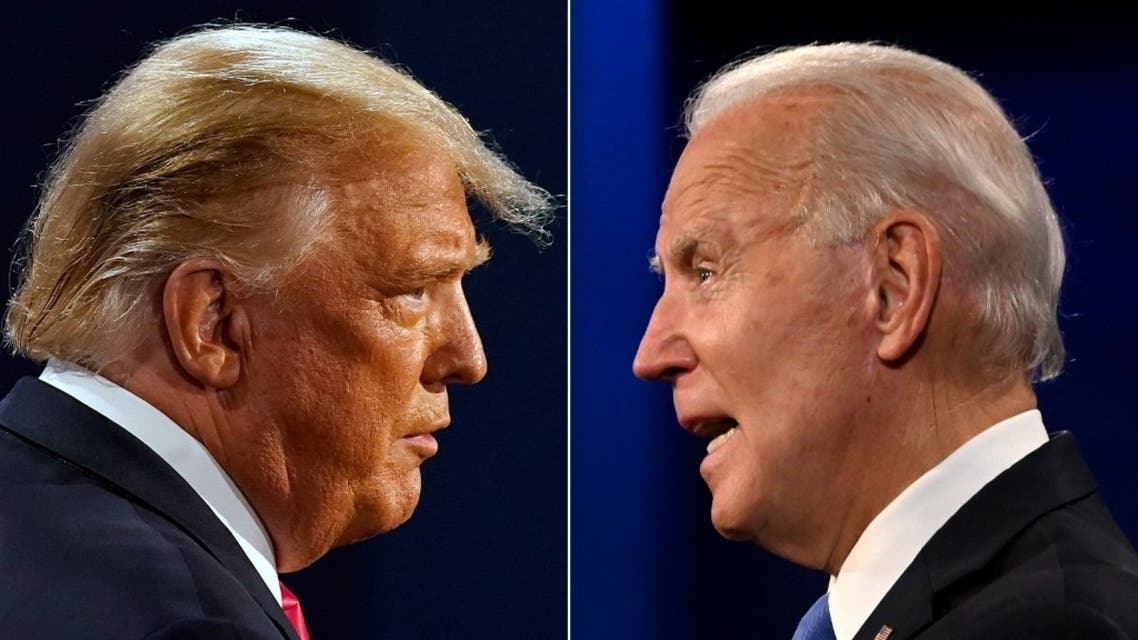 US President Donald Trump (L) and Democratic Presidential candidate and former US Vice President Joe Biden during the final presidential debate at Belmont University in Nashville, Tennessee, on October 22, 2020. (AFP)