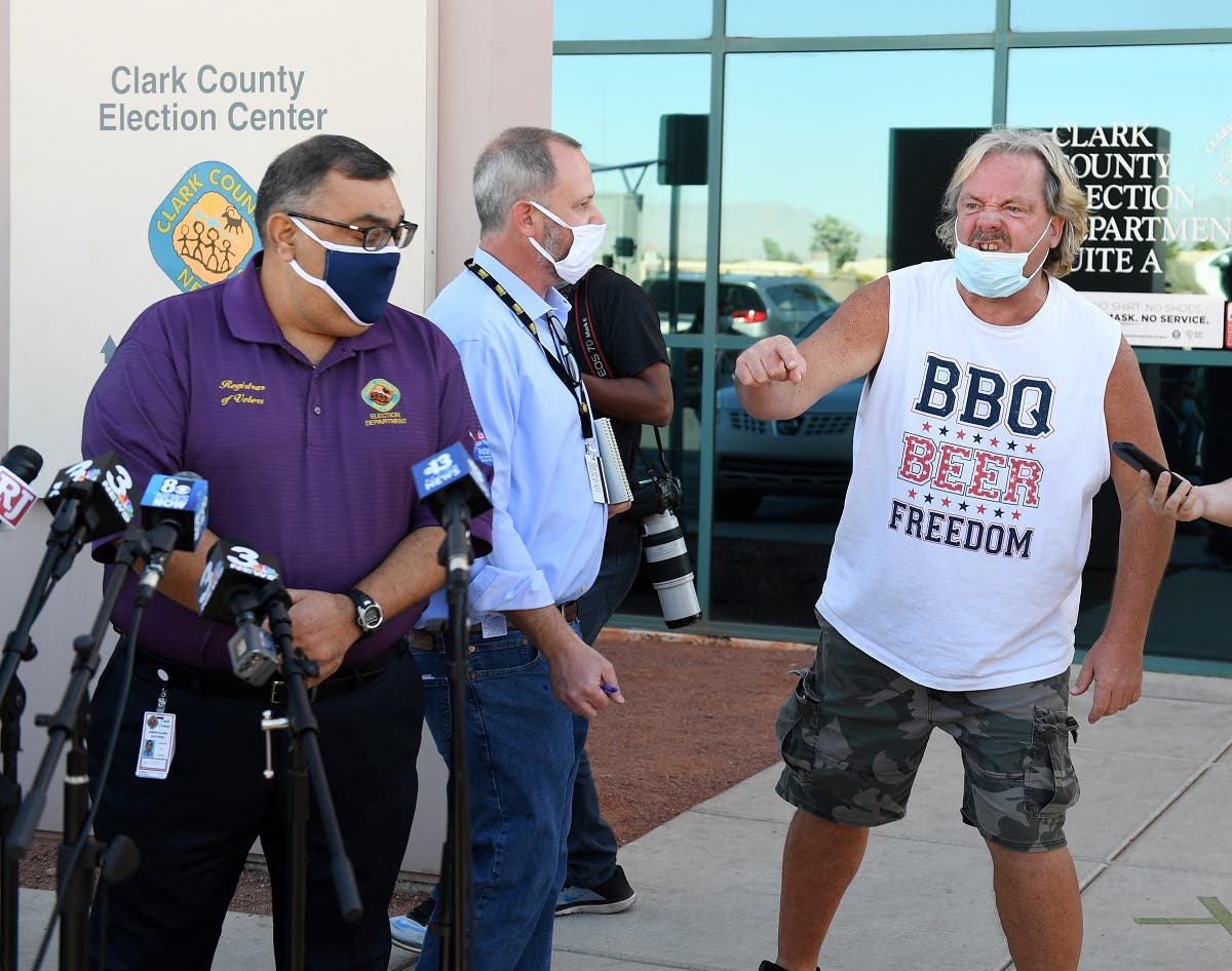 A protester interrupts a news conference by Clark County Registrar Joe Gloria (L) discussing ballot counting, Nov. 4, 2020 in Las Vegas, Nevada. (AFP)