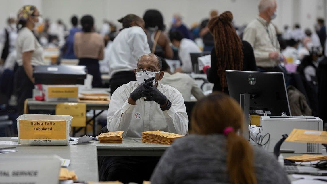 A worker with the Detroit Department of Elections waits for the next absentee ballot to be sorted through, Nov. 4, 2020 in Michigan. (AFP)