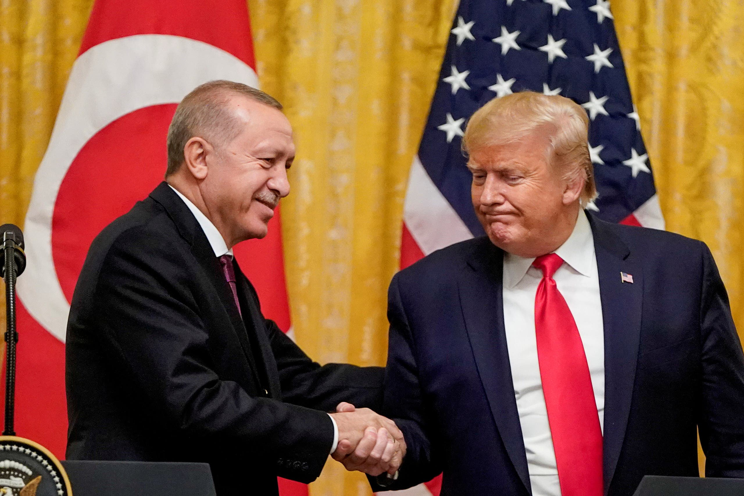 US President Donald Trump greets Turkey's President Tayyip Erdogan during a joint news conference at the White House in Washington, US, November 13, 2019. (Reuters)