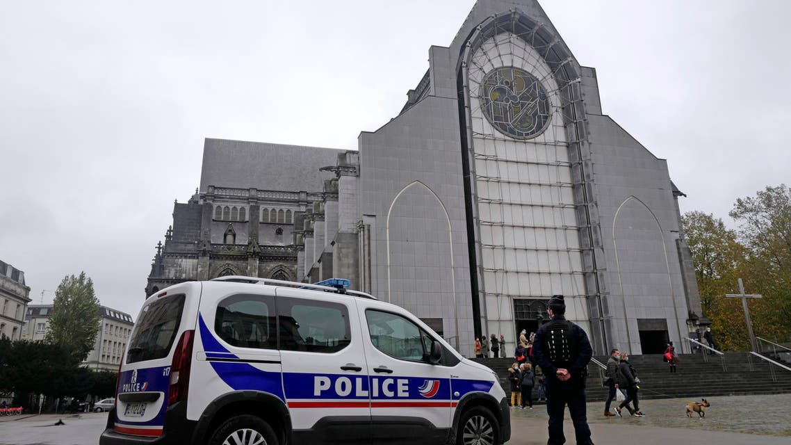French police officers stand guard outside Notre Dame church in Lille, northern France, Sunday, Nov. 1, 2020. (AP)