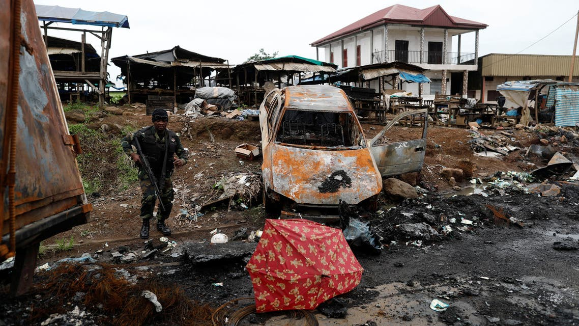 A Cameroonian elite Rapid Intervention Battalion (BIR) member walks past a burnt car while patroling in the city of Buea in the anglophone southwest region, Cameroon October 4, 2018. (Reuters)