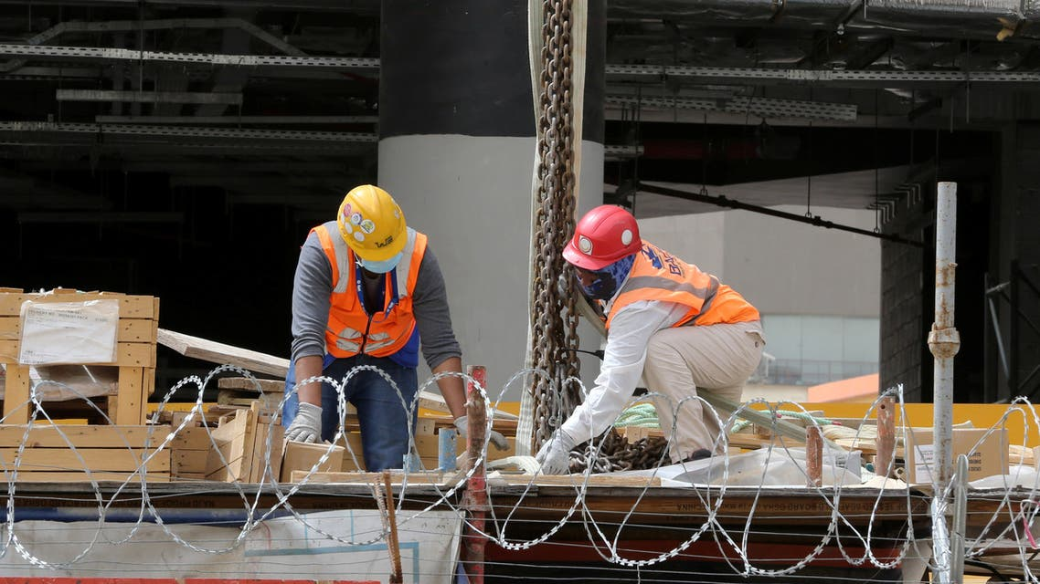 Foreign workers wearing protective face masks and gloves work at a construction site, following the outbreak of the coronavirus disease (COVID-19), in Riyadh. (Reuters)