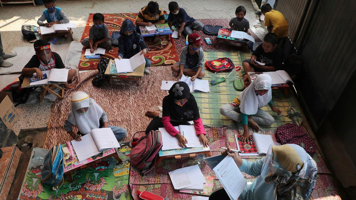 Indonesian teacher Inggit Andini, bottom right, teaches at a makeshift class for students who lack access to the internet to study online, at her residence in Tangerang, Indonesia, on Aug. 10, 2020. (AP)