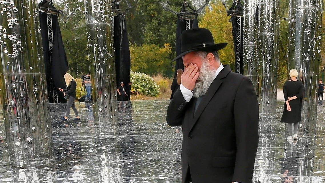 A Jewish man reacts during the opening ceremony of an installation commemorating the victims of Babyn Yar, Sept. 29, 2020. (Reuters)
