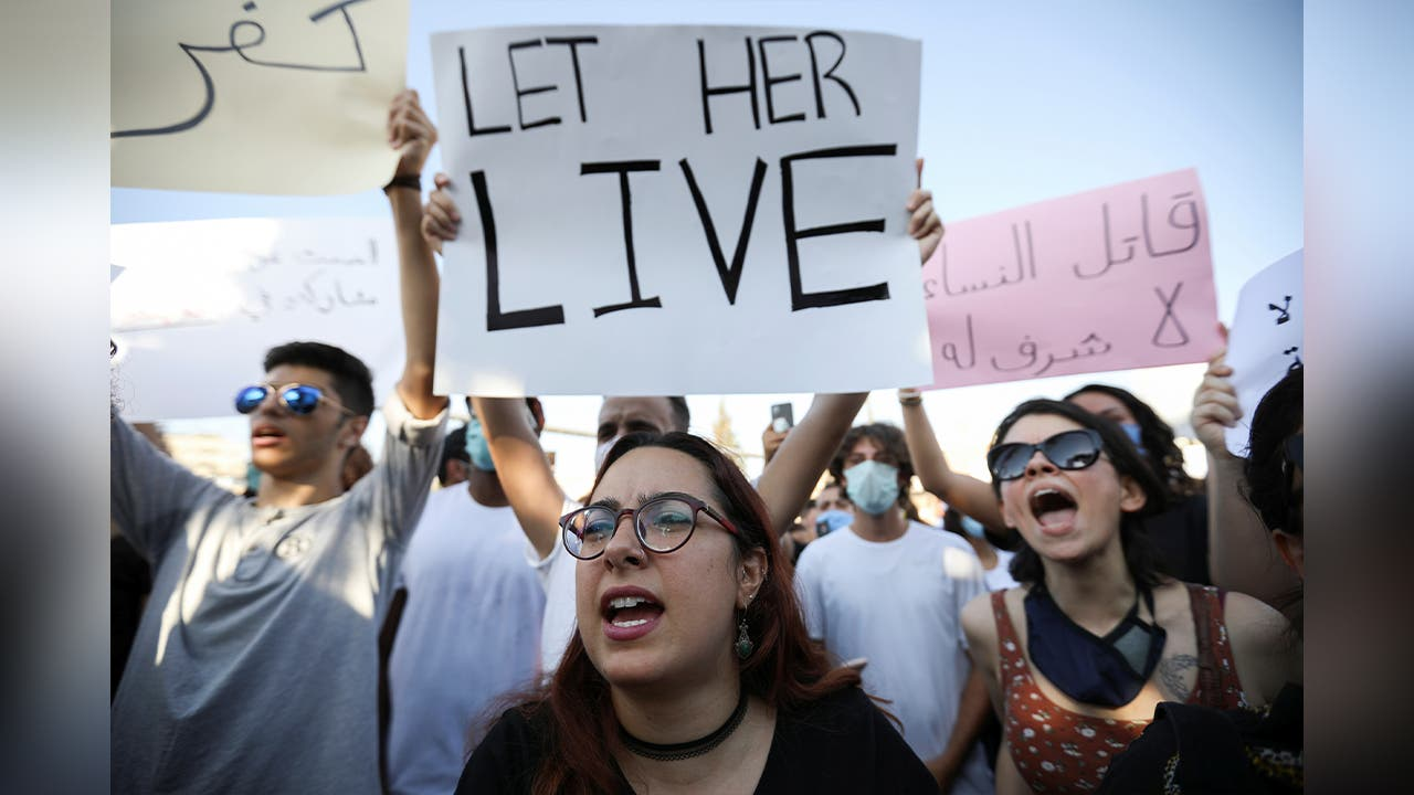 Demonstrators shout slogans during a protest against the incidents of violence against women and to demand more stringent consequences for perpetrators, in front of the Parliament in Amman. (File photo: Reuters)