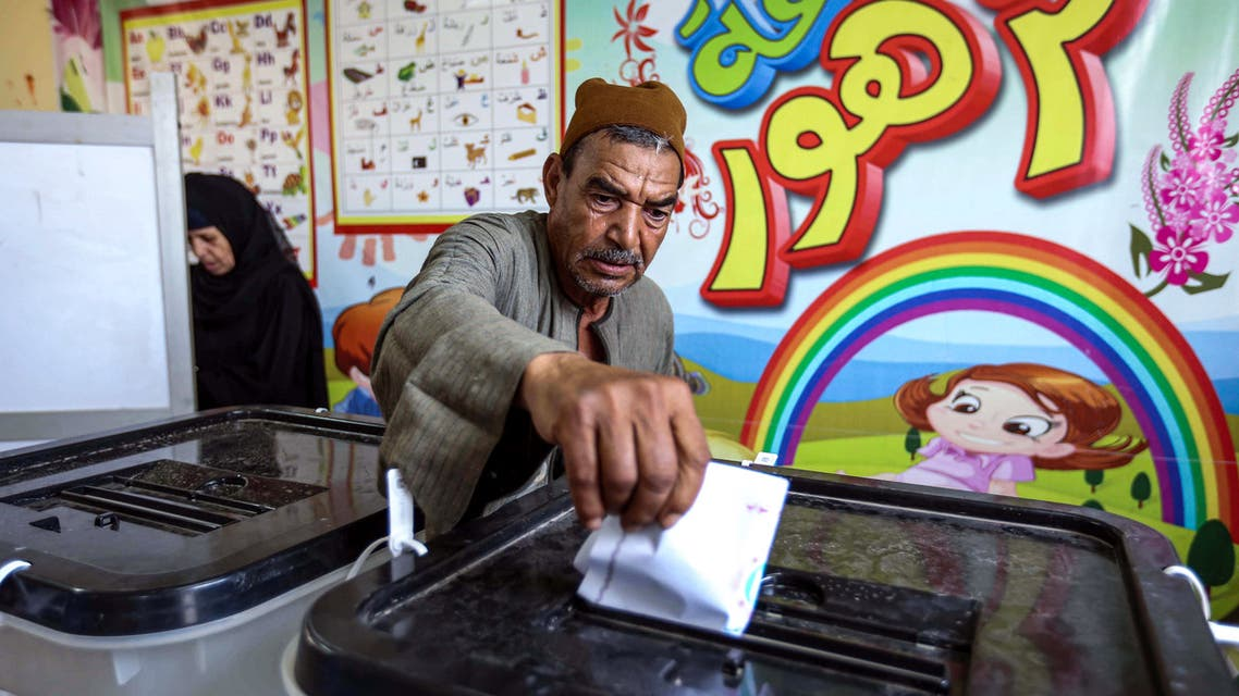 A man casts his ballot at a polling station in El-Ayyat, south of the Egyptian capital on October 24, 2020, during the first stage of the lower house elections. (AFP)
