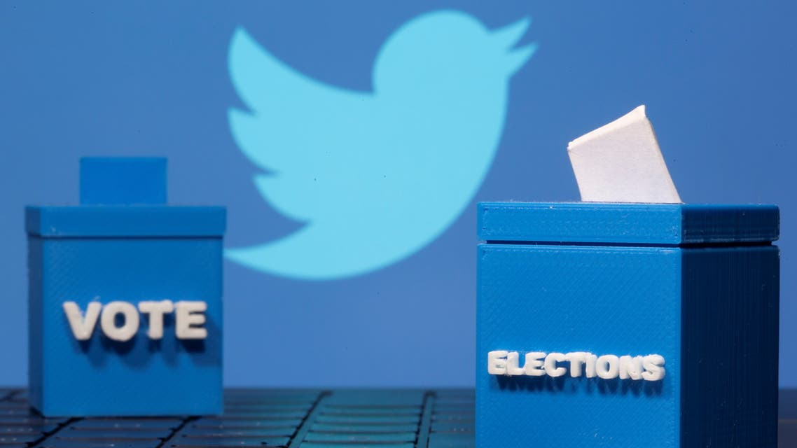 3D printed ballot boxes are seen in front of a displayed Twitter logo in this illustration taken November 4, 2020. REUTERS/Dado Ruvic/Illustration