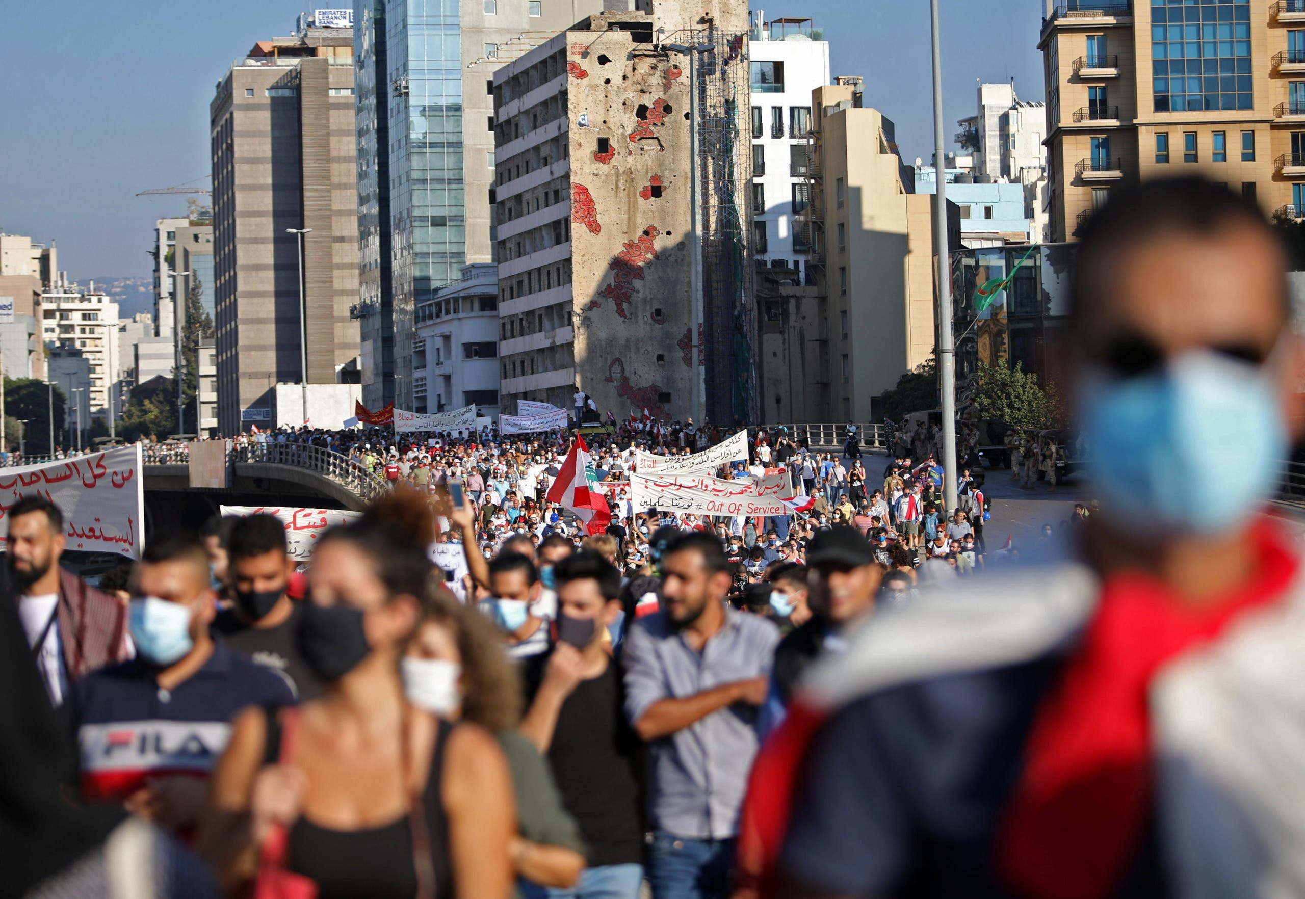 People march during a demonstration marking one year since the start of nation-wide protests in Beirut, Lebanon October 17, 2020. (Reuters)