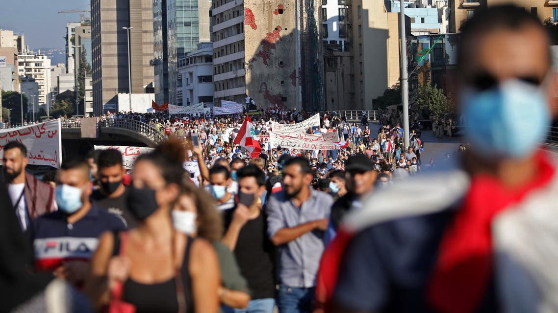 People march during a demonstration marking one year since the start of nation-wide protests in Beirut, Lebanon October 17, 2020. REUTERS/Emma Freiha