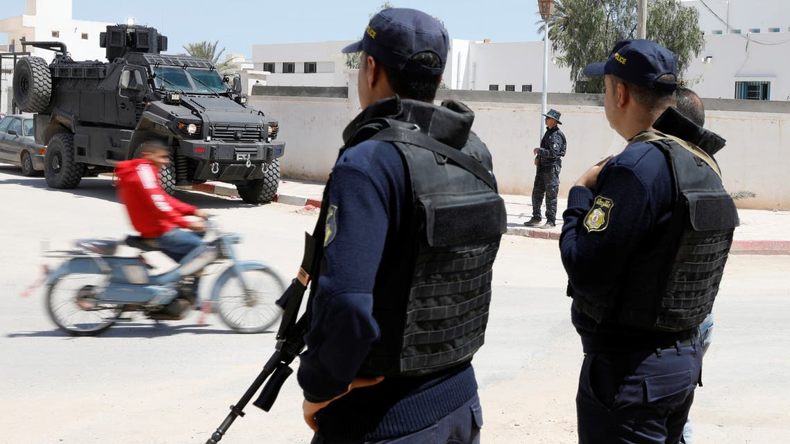 Police officers stand guard in the town of Ben Guerdane, near the Libyan border, Tunisia April 16, 2019. Picture taken April 16, 2019. REUTERS/Zoubeir Souissi