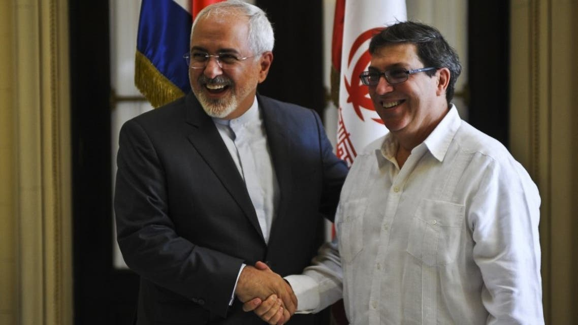 Iran's Foreign Minister Mohammad Javad Zarif (L) shakes hands with his Cuban counterpart Bruno Rodriguez in Havana. (File photo: AFP)