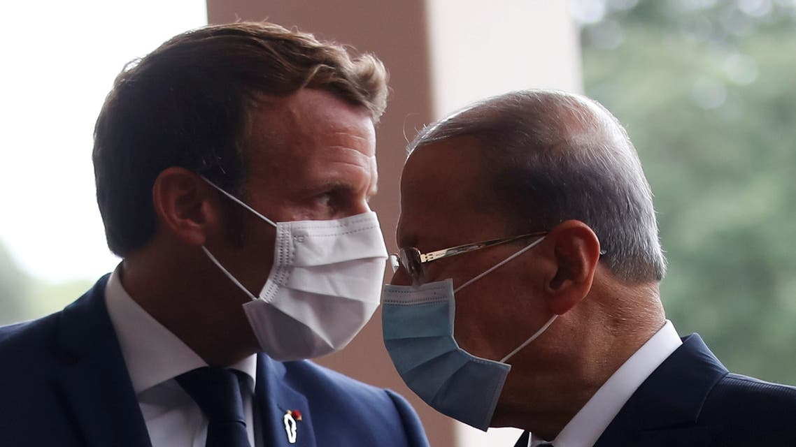 FILE PHOTO: FILE PHOTO: French President Emmanuel Macron and Lebanon's President Michel Aoun wear face masks as they arrives to attend a meeting at the presidential palace in Baabda, Lebanon September 1, 2020. REUTERS/Gonzalo Fuentes/Pool/File Photo