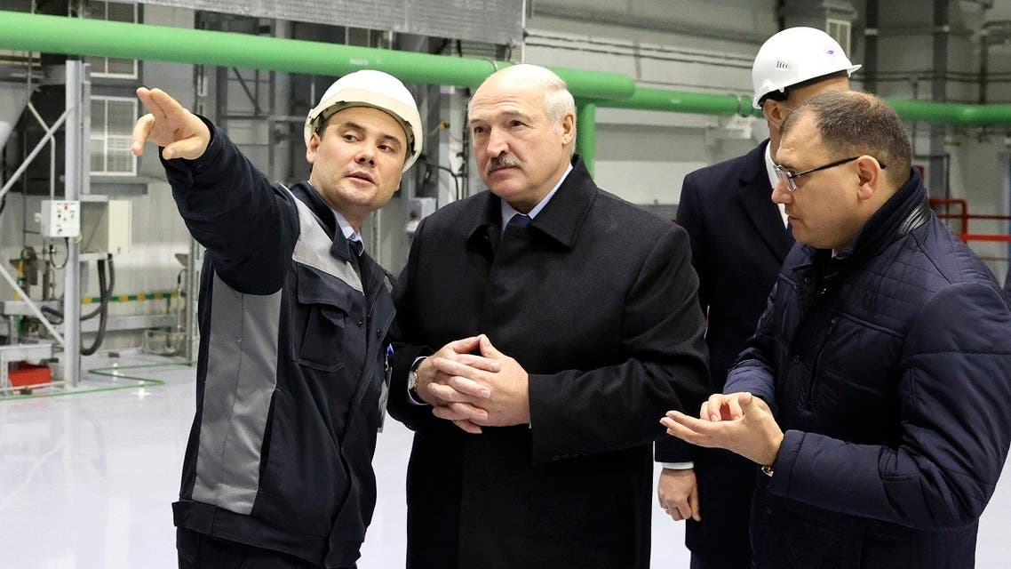 Belarusian President Alexander Lukashenko, centre, attends the first Belarusian Nuclear Power Plant during the plant's power launch event outside the city of Astravets, Belarus, Saturday, Nov. 7, 2020. (Maxim Guchek/BelTA Pool Photo via AP)
