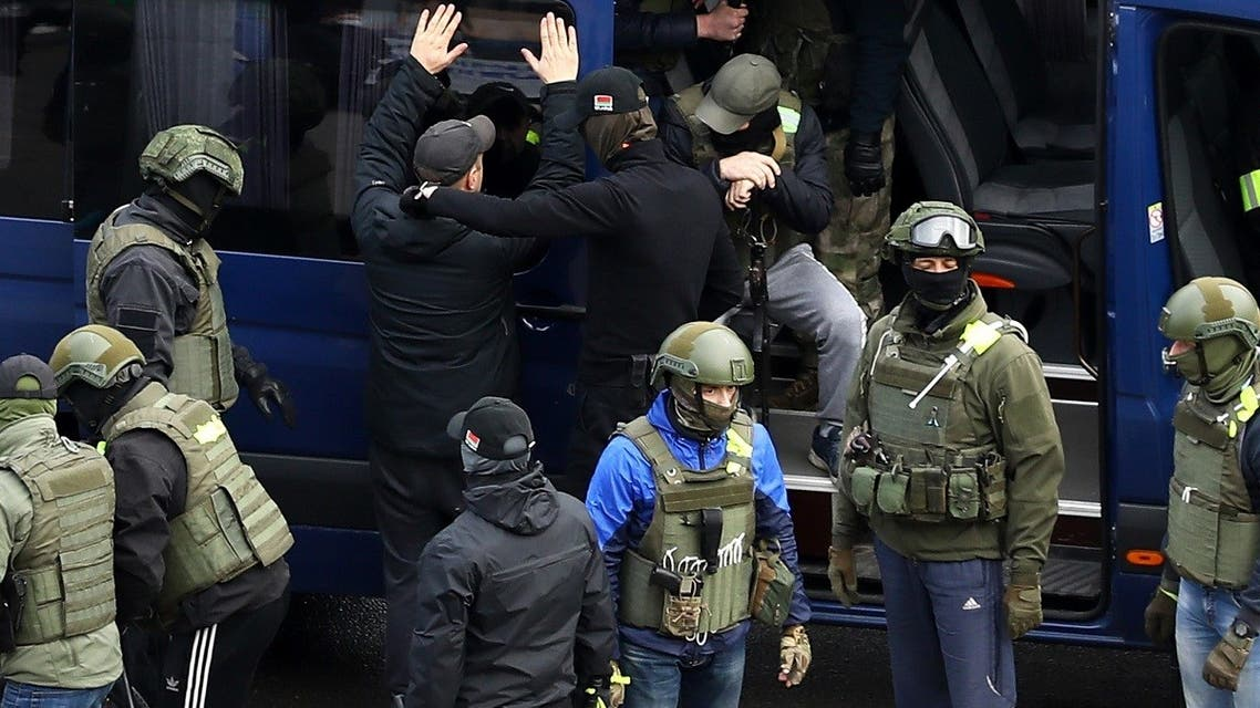 """Law enforcement officers detain a man during an opposition rally called """"the March of Democracy"""" to protest against the Belarus presidential election results in Minsk, on November 8, 2020. (Stringer/AFP)"""