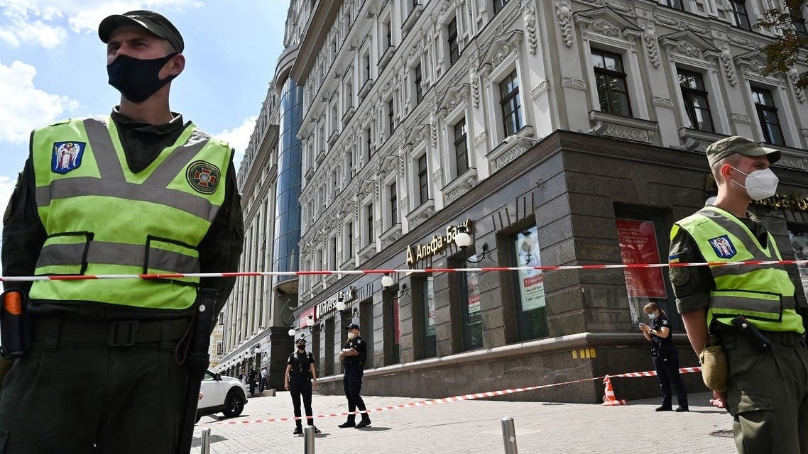 A file photo shows Ukraine's police officers stand guard as members of Ukrainian special forces storm in a bank in the center of Ukrainian capital, Kiev, on August 3, 2020, where a man has taken an hostage. (Sergei Supinsky/AFP)