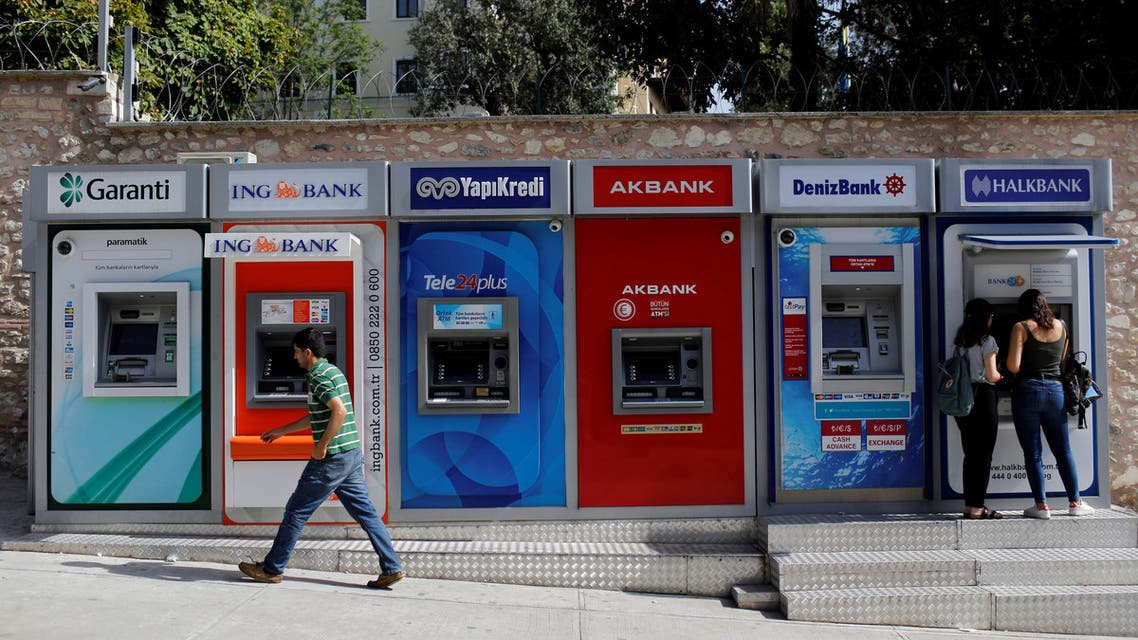 Women withdraw cash from an ATM of Halkbank in Istanbul, Turkey, September 12, 2017. (Reuters)