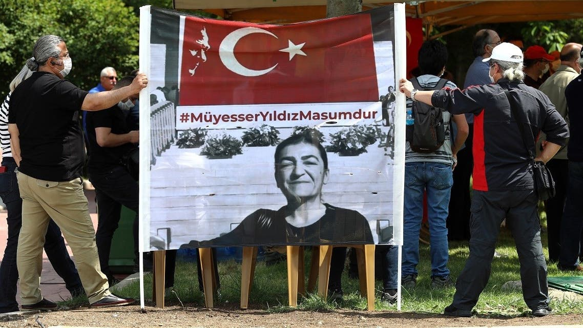 People hold up a banner as they gather to denounce the arrest of one of two journalists, Muyesser Yildiz, a news coordinator at OdaTV online news site, during a rally in Ankara on June 18, 2020. (Adem Altan/AFP)