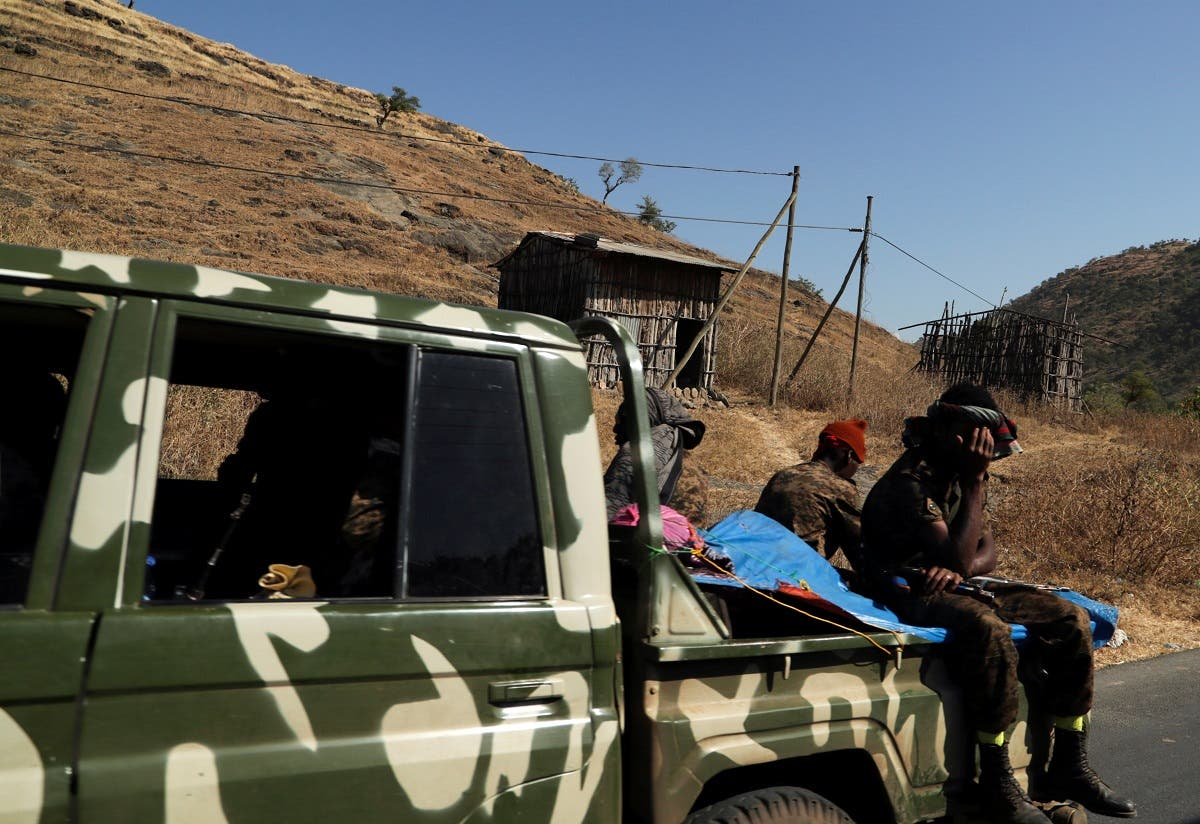 Members of Ethiopian National Defense Force (ENDF) ride on their pickup truck as they head to mission, in Sanja, Amhara region near a border with Tigray, Ethiopia November 9, 2020. (Reuters/Tiksa Negeri)