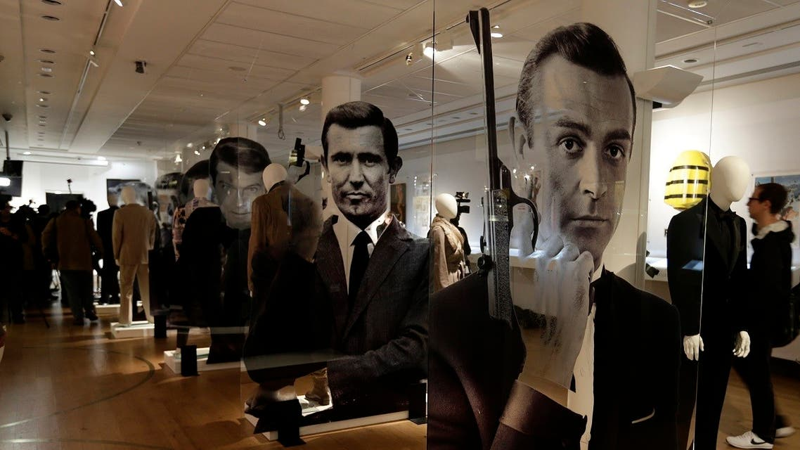 A general view of the James Bond movie memorabilia charity auction at Christie's auction house during the press pre-view showing large portraits of the actors who have portrayed the famous movie icon James Bond, with Sean Connery. (AP)
