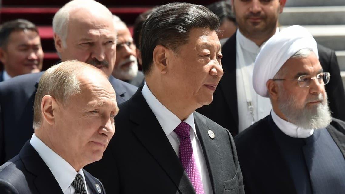 Russian President Vladimir Putin, Chinese President Xi Jinping and Iran's President Hassan Rouhani walk in Bishkek on June 14, 2019. (AFP)