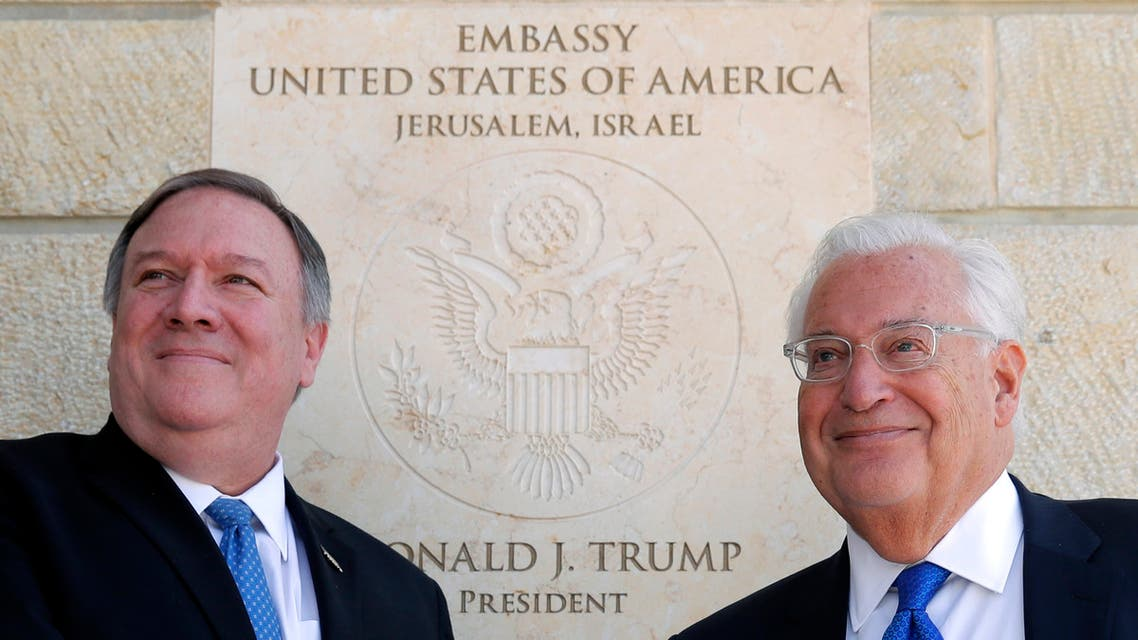 US Secretary of State Mike Pompeo and US Ambassador to Israel David Friedman stand next to the dedication plaque at the US embassy in Jerusalem on March 21, 2019. (AP)
