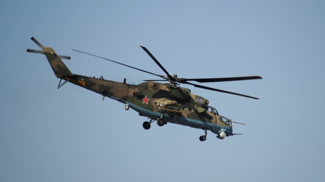A Russian Mi-24 helicopter flies at the Russian military base of Hmeimim, located south-east of the city of Latakia in Hmeimim, Latakia Governorate, Syria. (File photo: AFP)