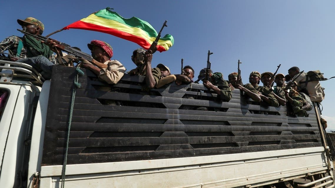 Members of Amhara region militias ride on their truck as they head to face the Tigray People's Liberation Front (TPLF), in Sanja, Amhara region near a border with Tigray, Ethiopia November 9, 2020. (Reuters/Tiksa Negeri)