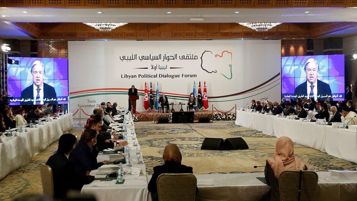 UN Secretary-General Antonio Guterres is seen on screens during the Libyan Political Dialogue Forum in Tunis, Tunisia November 9, 2020. (Reuters/Zoubeir Souissi)