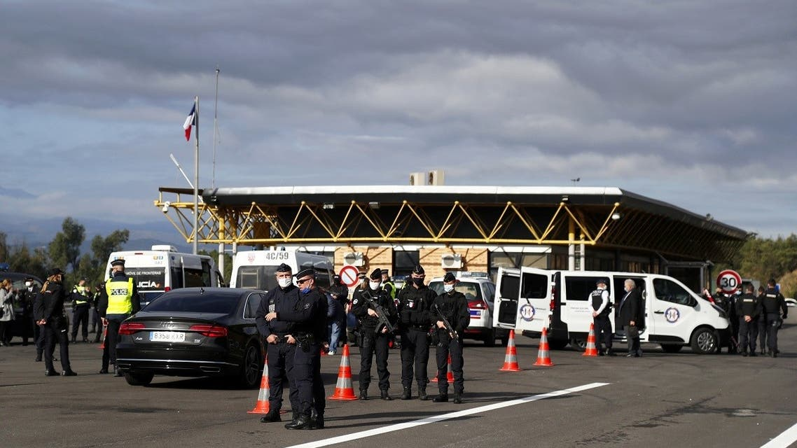 French police officers control the border crossing between Spain . (Reuters)