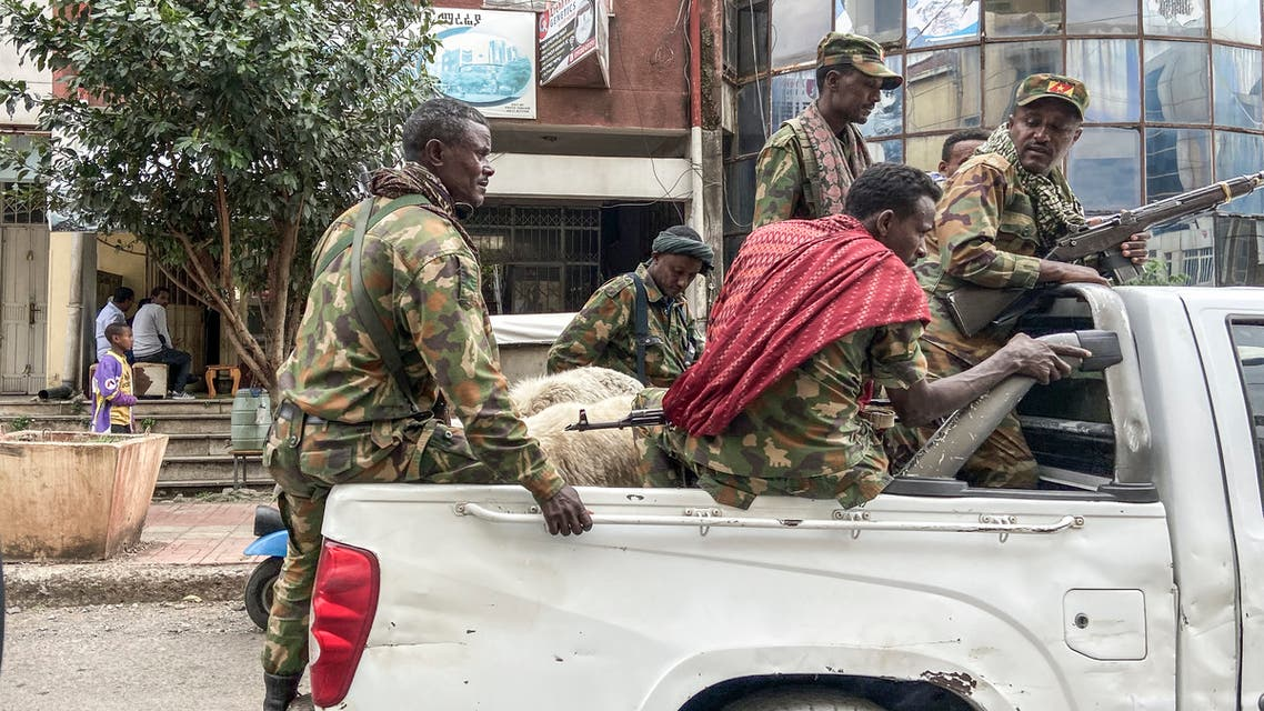 Members of the Amhara militia, that combat alongside federal and regional forces against northern region of Tigray, ride on the back of a pick up truck in the city of Gondar, on 08 November 2020.