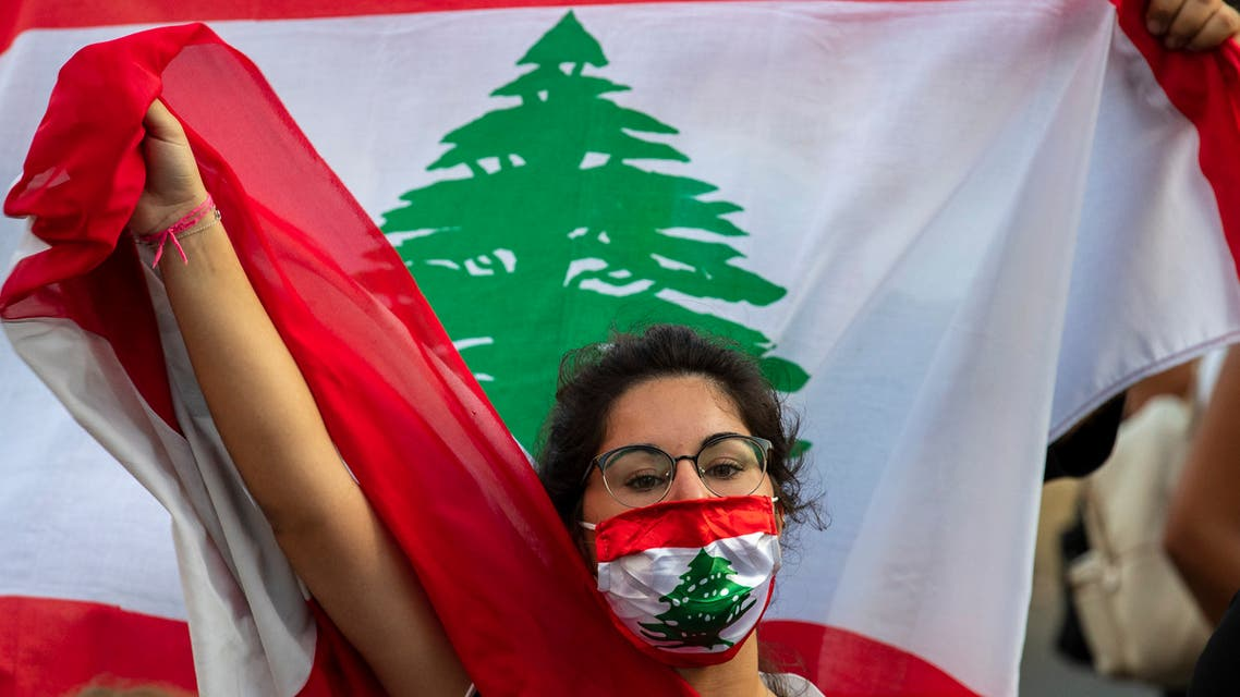 An anti-government protester shouts slogans while wearing a mask with the colors of the Lebanese flag in Beirut, Lebanon, Thursday, July 2, 2020. (AP)