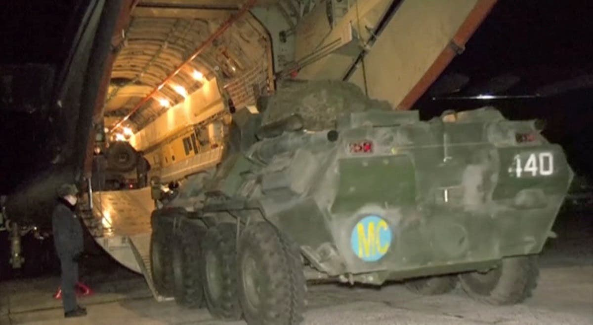 A still image from a video released by Russia's Defense Ministry shows an armored vehicle driving into a transport plane as Russian peacekeepers depart for the region of Nagorno-Karabakh at an airdrome in Ulyanovsk, Russia November 10, 2020. (Russian Defense Ministry/Handout via Reuters TV)