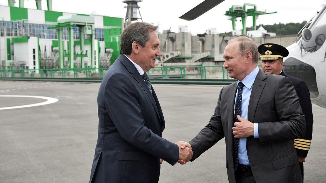 President Vladimir Putin shakes hands with Nikolai Shulginov, the head of state hydropower producer RusHydro, upon arriving at the Nizhne-Bureiskaya hydroelectric power plant, Russia. (File photo: Reuters)