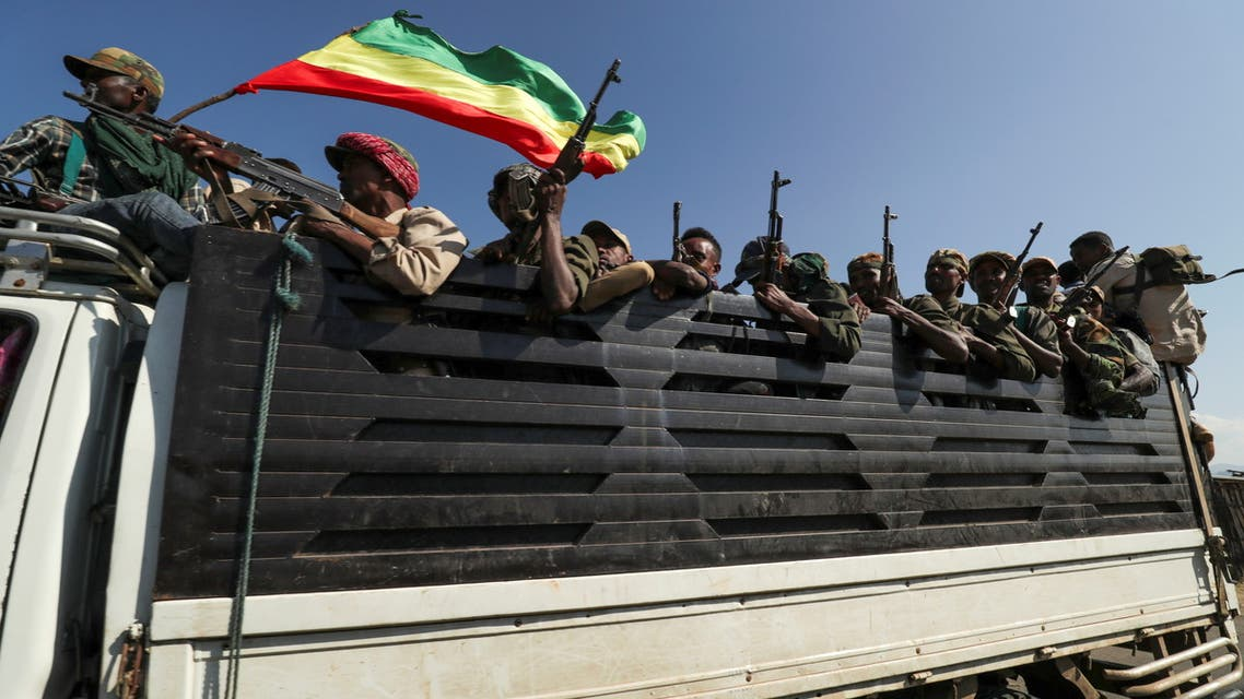 Members of Amhara region militias ride on their truck as they head to face the TPLF, in Sanja, Amhara region near a border with Tigray, Ethiopia Nov. 9, 2020. (Reuters)