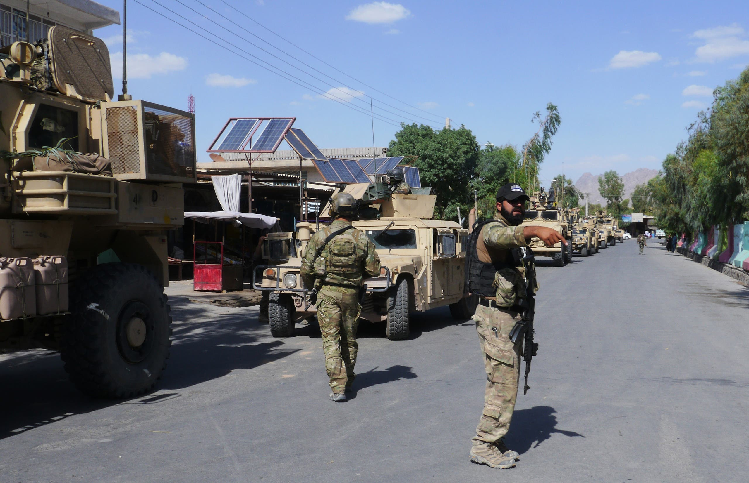 In this photograph taken on May 19, 2018, Afghan security forces patrol, after recapturing control of the city from Taliban militants, in Farah. Afghan commandos and US air strikes have driven the Taliban to the outskirts of Farah city, officials said May 16, after a day-long battle to prevent the insurgents from seizing the western provincial capital. (AFP)