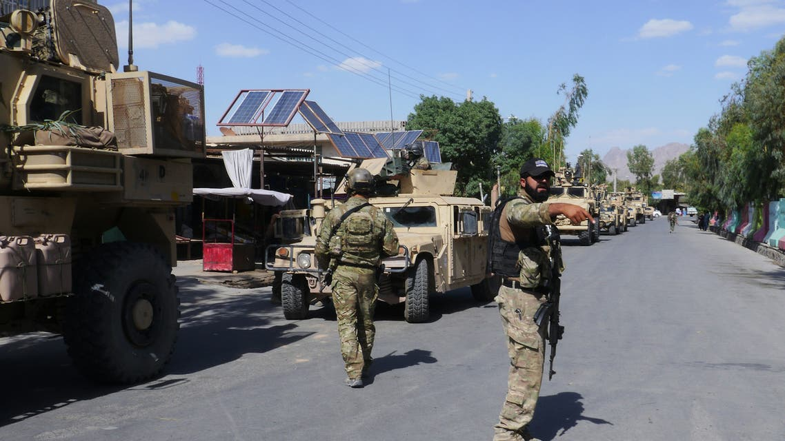 In this photograph taken on May 19, 2018, Afghan security forces patrol, after recapturing control of the city from Taliban militants, in Farah. Afghan commandos and US air strikes have driven the Taliban to the outskirts of Farah city, officials said May 16, after a day-long battle to prevent the insurgents from seizing the western provincial capital.