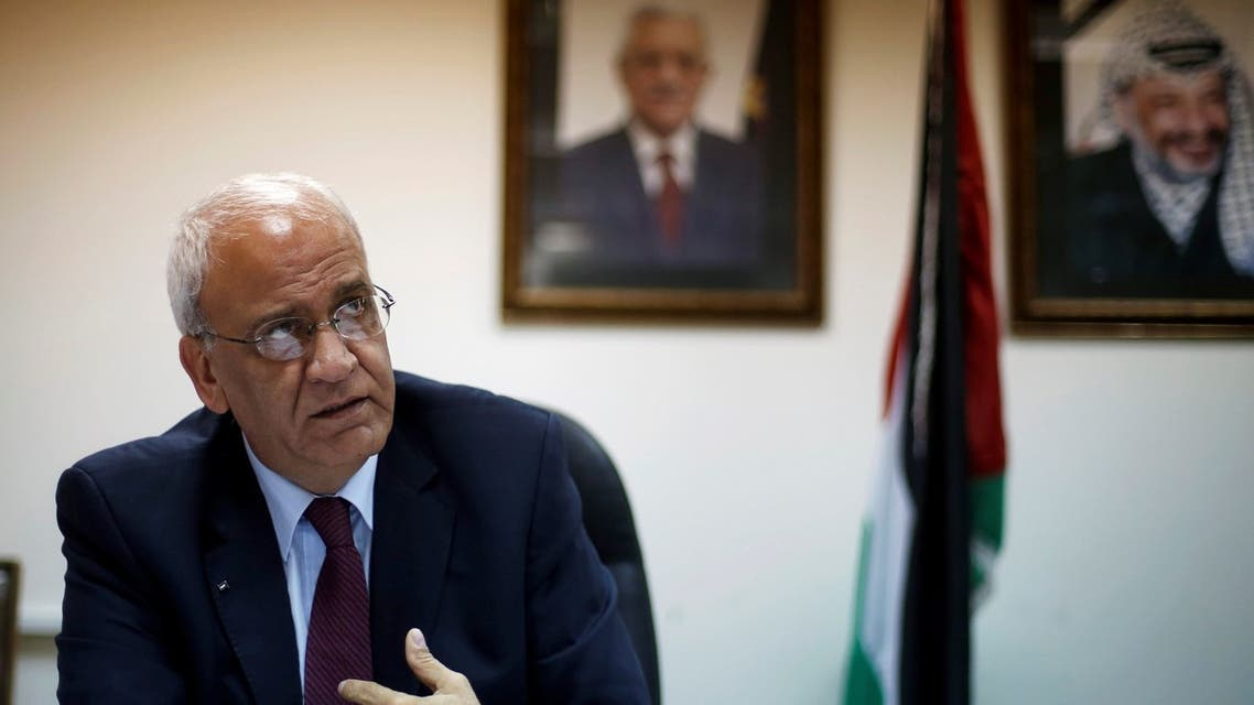 Palestinian chief negotiator Saeb Erakat gestures during his interview with Reuters in the West Bank city of Ramallah August 11, 2013. (Reuters)