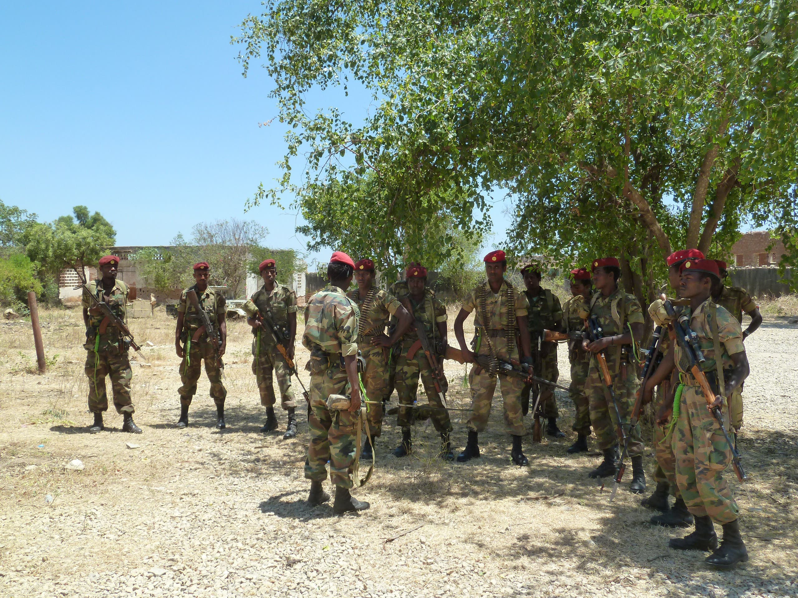 A picture taken on March 2, 2012 shows Ethiopian soldiers receiving a briefing before displaying of weapons left behind by Shebab militias at their former base in Baido, Somalia, which was taken over from al Shabab rebels on February 22. (AFP/Jenny Vaughan)