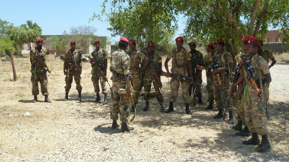A picture taken on March 2, 2012 shows Ethiopian soldiers receiving a briefing before displaying of weapons left behind by Shebab militias at their former base in Baido, which was taken over from Shebab rebels on February 22. Truckloads of Ethiopian and Somali troops on February 22 captured the strategic Somali city of Baidoa from Al-Qaeda-allied Shebab insurgents, who vowed to avenge their biggest loss in several months. Baidoa, 250 kilometres (155 miles) northwest of the capital Mogadishu, was the seat of Somalia's transitional parliament until the hardline Shebab captured it in 2009. Ethiopia says it is in the country to support Somalia's transitional government to stamp out Shebab insurgents, but says it does not plan to remain in the country for the long term. AFP PHOTO / JENNY VAUGHAN