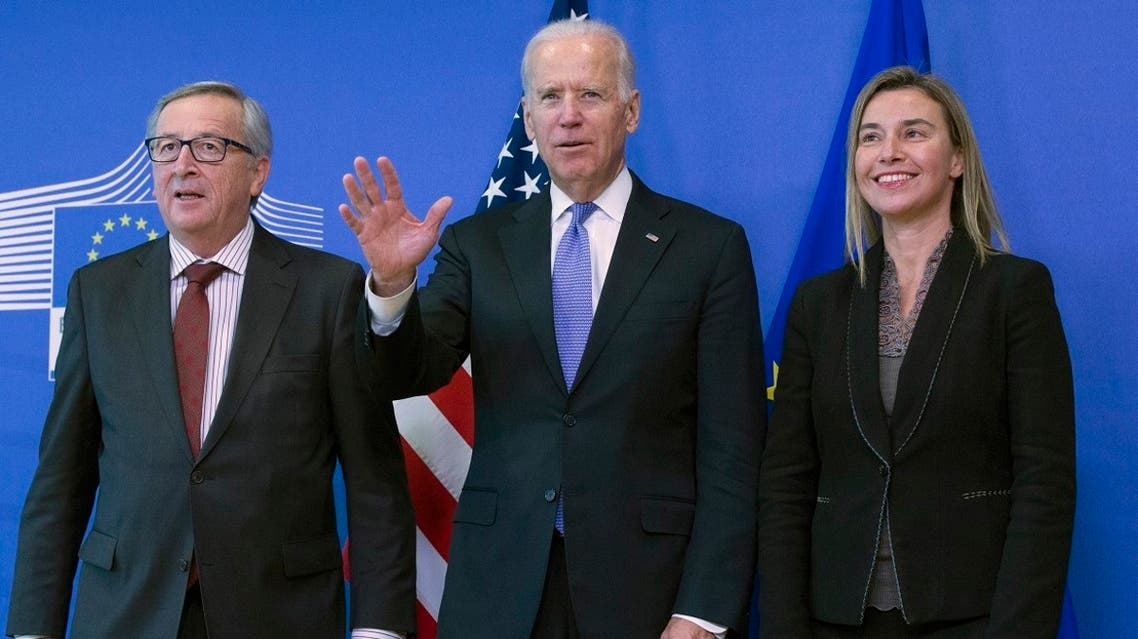 European Commission President Jean-Claude Juncker (L) and EU foreign policy chief Federica Mogherini (R) welcome VP Joe Biden at the EU Commission headquarters in Brussels, Feb. 6, 2015. (Reuters)