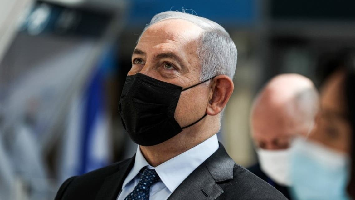 Israeli Prime Minister Benjamin Netanyahu attends while mask-clad the inauguration of a COVID-19 coronavirus rapid testing centre at Ben Gurion International Airport in Lod on November 9, 2020. (AFP)