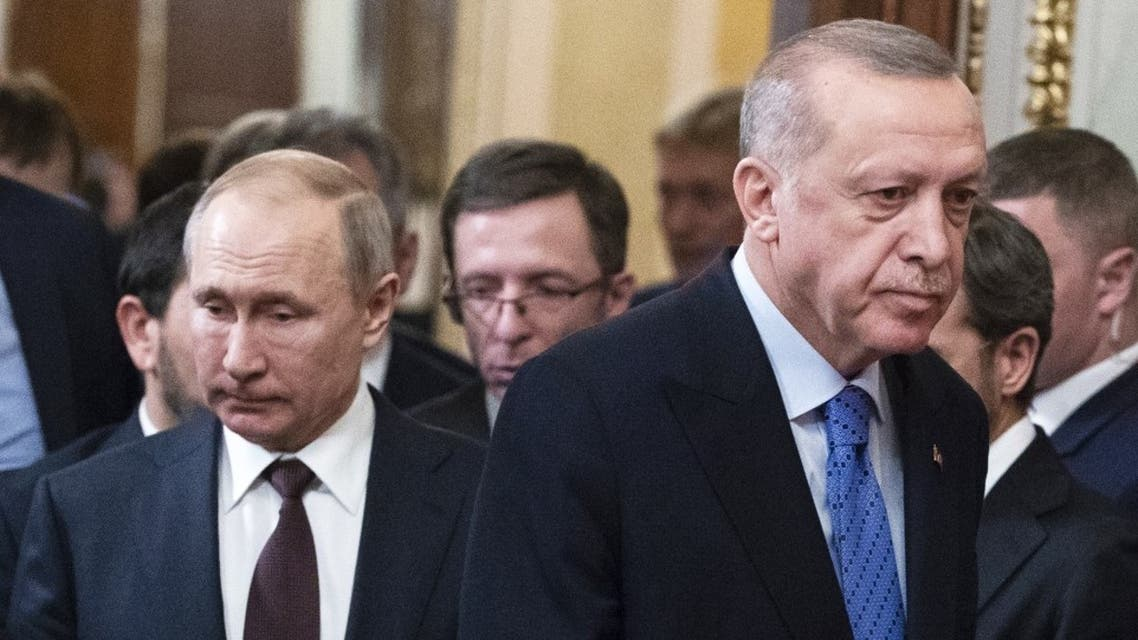 Russian President Vladimir Putin and his Turkish counterpart Recep Tayyip Erdogan arrive to hold a joint press statement following their talks at the Kremlin in Moscow on March 5, 2020. (AFP)