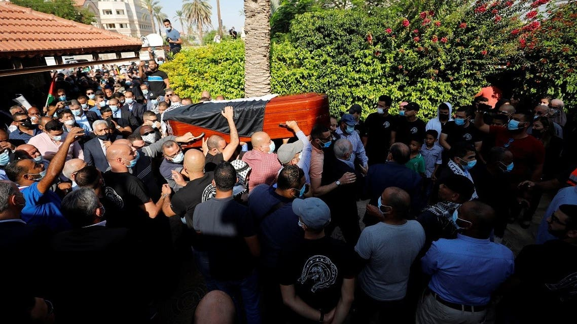 Mourners carry the coffin of chief Palestinian negotiator Saeb Erekat, who died after contracting the coronavirus, during his funeral in Jericho in the Israeli-occupied West Bank on November 11, 2020. (Reuters)