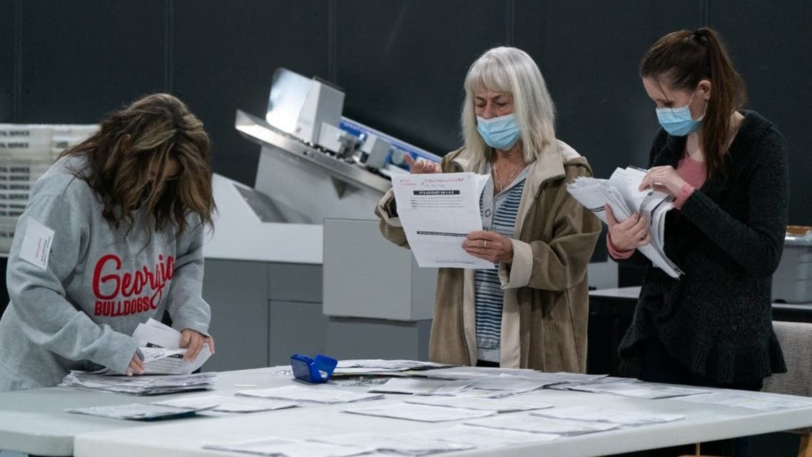 Election personnel sort absentee ballot applications for storage at the Gwinnett County Board of Voter Registrations and Elections offices on November 7, 2020 in Lawrenceville, Georgia. (AFP)