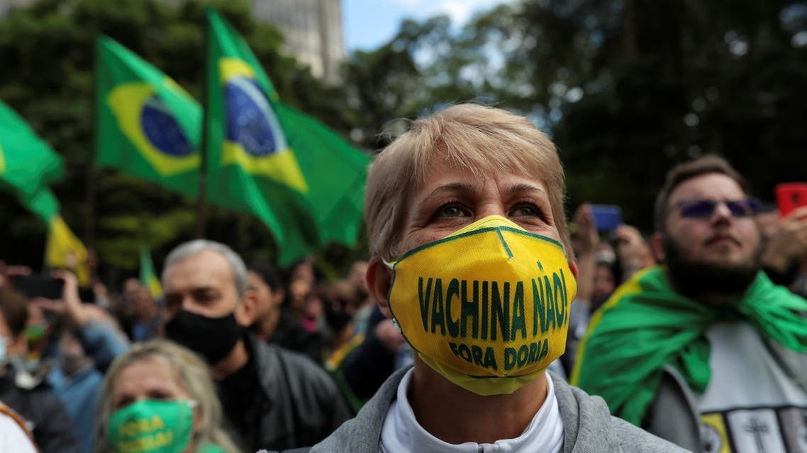 Demonstrators protest against Sao Paulo state governor Joao Doria and China's Sinovac potential coronavirus disease (COVID-19) vaccine in Sao Paulo, Brazil, November 1, 2020. REUTERS/Amanda Perobelli