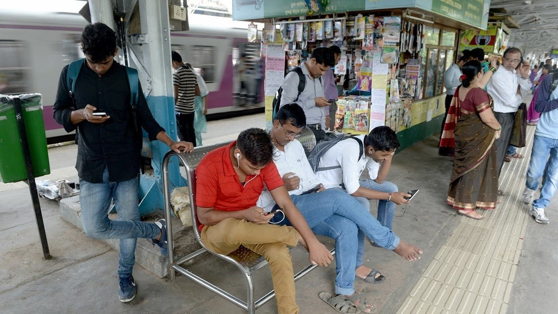 A file photo shows Indians surf the internet on their phones at a free wi-fi zone inside a suburban railway station in Mumbai on August 22, 2016. (Indranil Mukherjee/AFP)